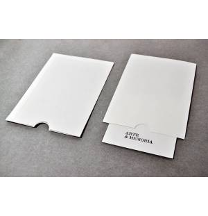 Envelope with thumb notch